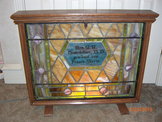 This is a display cabinet for an old church stained glass window